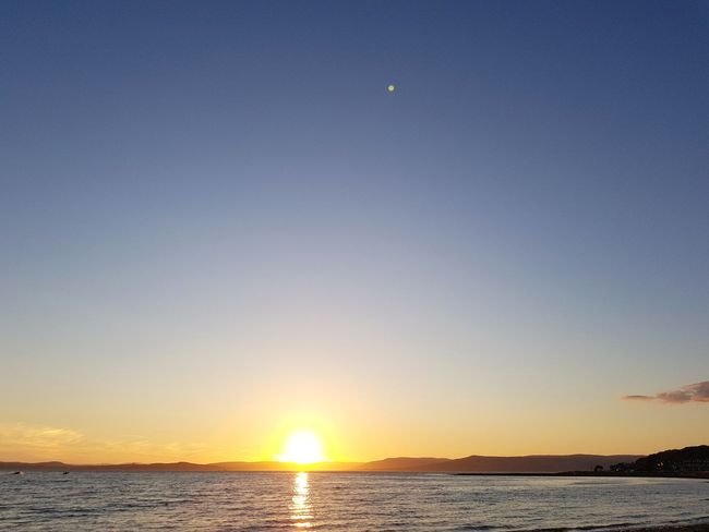 Clear Sky Sunset Sea Sun Nature Scenics Sky Beach Outdoors Tranquility Tranquil Scene Beauty In Nature Water Travel Destinations Landscape Sunlight No People Silhouette Vacations Horizon Over Water Clear Sky