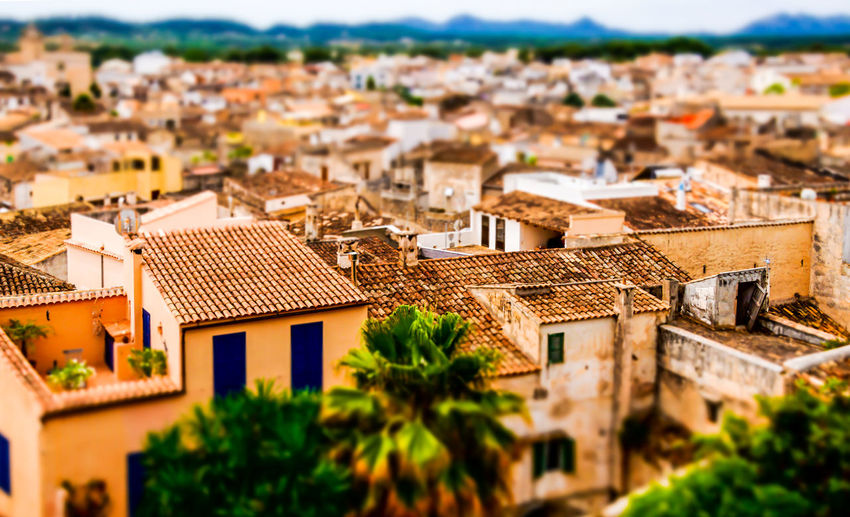 Tilt-shift image of houses in town