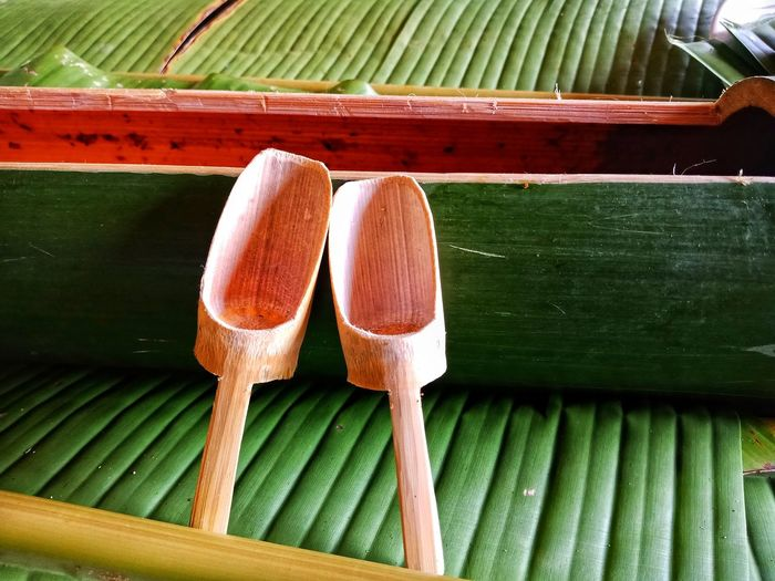 Close-up of wooden ladles