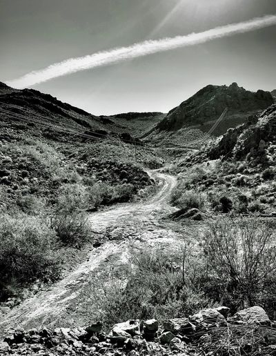 """There's Gold In Them Thar Hills"" A working gold mine road along historic Route 66 from Kingman, Arizona to Oatman, Arizona. Black And White Photography Blackandwhite Photography Black & White Black And White Blackandwhite Arizona Dirt Road Rough Roads Gold Mine Sky Day Cloud - Sky Nature No People Tranquility Landscape Outdoors Mountain Scenics - Nature"
