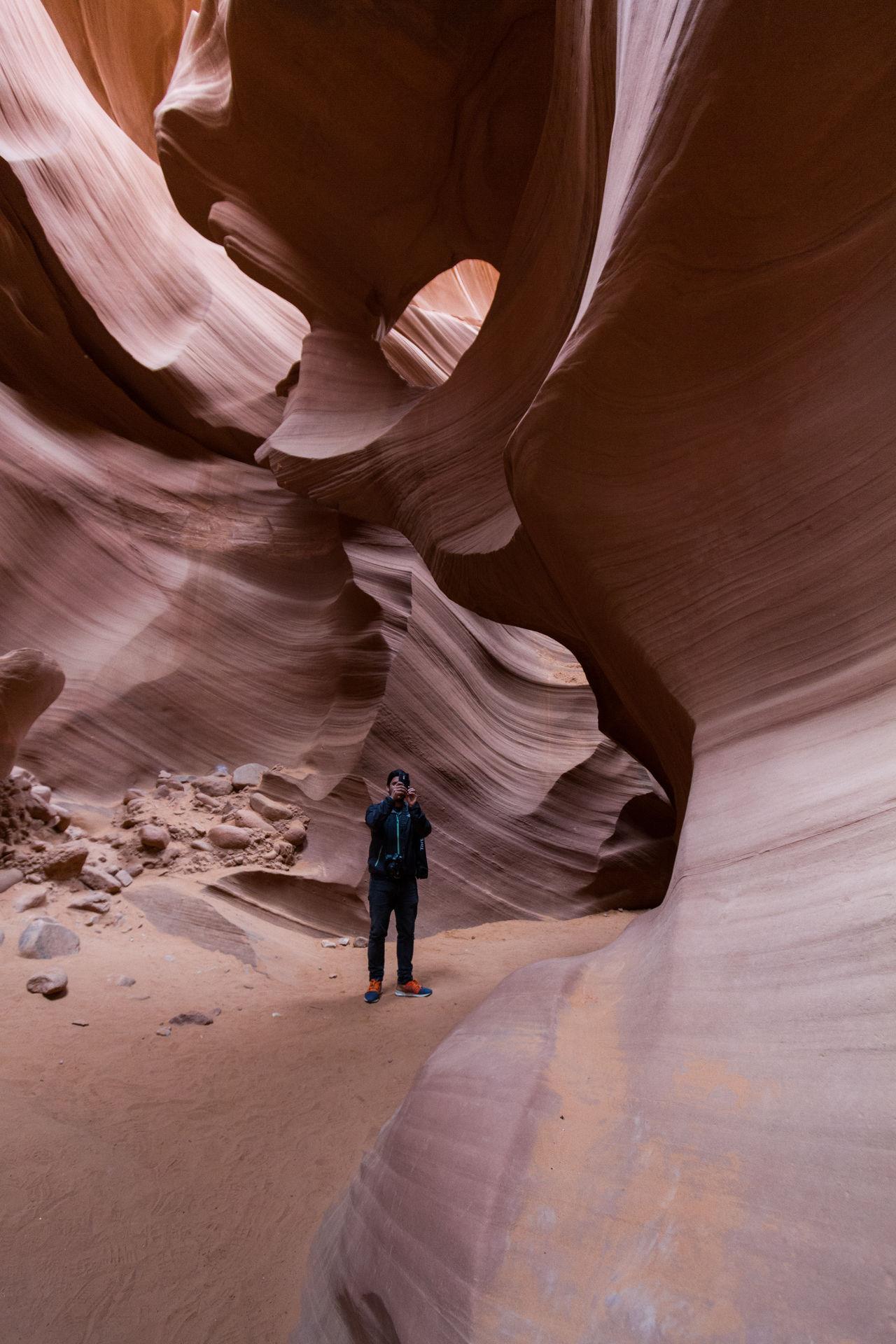 Man standing in antelope canyon