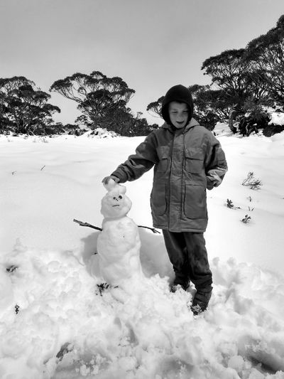 Snow in the Late Spring 😱 Spring Snowman Funtimes Black And White Photography Black And White Streetphotography Nature Photography Portrait Cold Wet Life Monochrome Fog Trees Rewilding EueEmNewHere EyeEmNewHere EyeEm Best Shots Warm Clothing Snow Full Length Cold Temperature Portrait Standing Smiling Moments Of Happiness