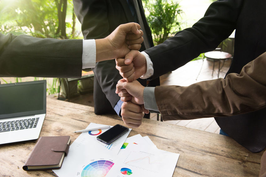 businessman make a sign together with notebook laptop and wooden desk background Business Office Sign Statistic Suit Trading URGENT Analyzing Businessman Coorporate Display Document Forex Graph Handshake Investment Jointventure Laptop Manager Occupation Professional Stock Team Up Together Trade