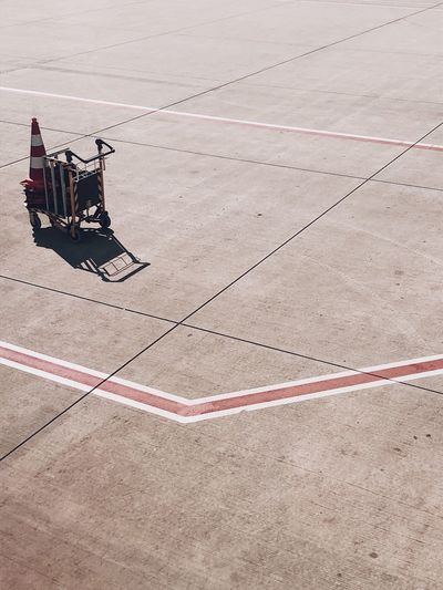 High angle view of luggage cart on airport runway