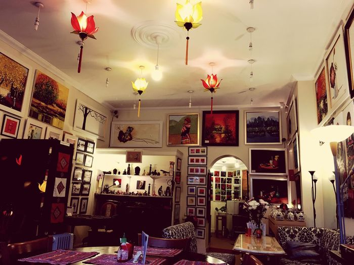 Vietnam Art Gallery & Restaurant Indoors  Large Group Of Objects Men Hanging Lighting Equipment Variation Illuminated Person Choice Collection Arrangement Casual Clothing Modern Lobby Decoration Abundance Dining Retail  First Eyeem Photo