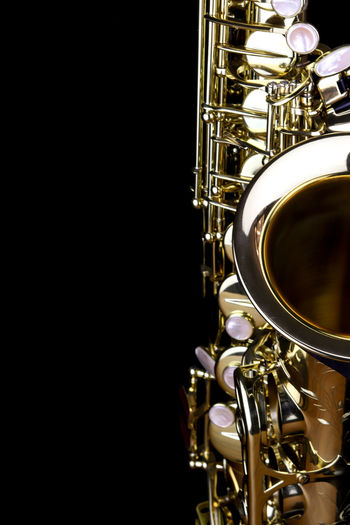 Music Instrument Alto Saxophone, Saxophone Isolated on black Musical Instrument Music Studio Shot Black Background Arts Culture And Entertainment Brass Brass Instrument  Indoors  Metal Close-up Gold Colored Wind Instrument Copy Space Shiny Musical Equipment Trumpet No People Still Life Jazz Music Colored Background Stage Silver Colored