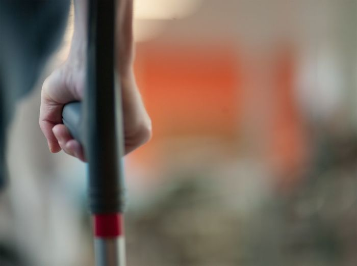 Cropped image of disabled person walking cane