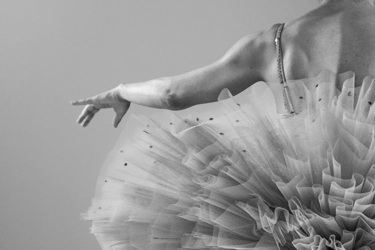 Midsection Of Ballet Dancer Against Black Background