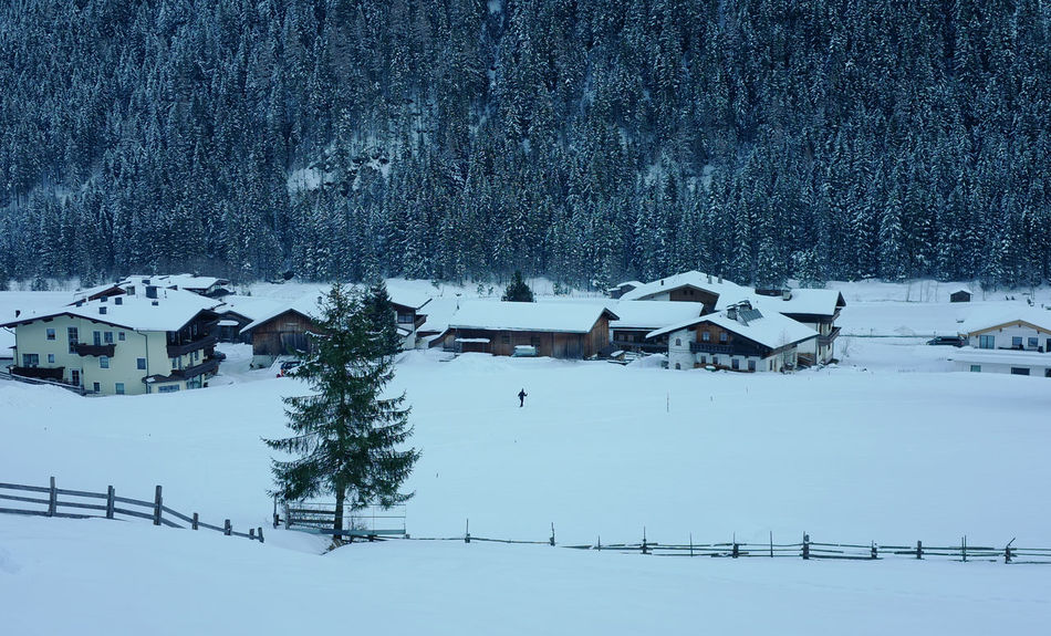 Calm Loneliness Architecture Beauty In Nature Building Exterior Built Structure Cold Cold Temperature Cross Country Skking Day Frozen House Landscape Mountain Nature No People One Person Outdoors Scenics Snow Snowdrift Tree Weather White Color Winter