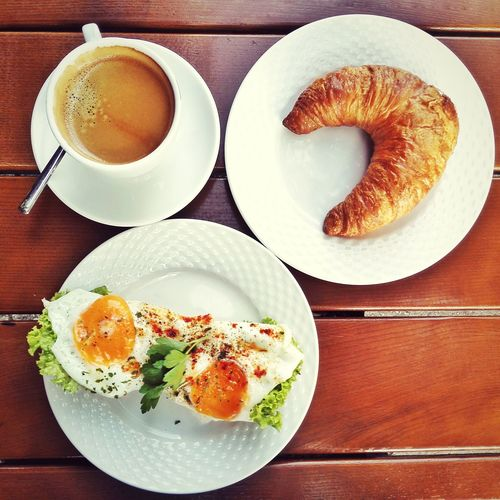 High Angle View Of Croissant And Sandwich Served With Coffee On Table