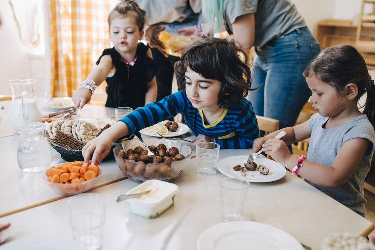 High angle view of people having food on table