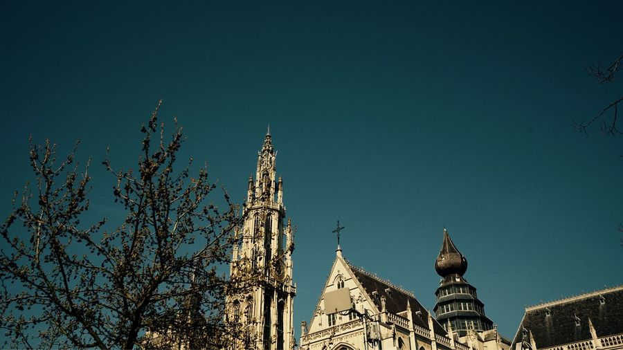 March 2019 Antwerpen City Cityscape Tourism Copy Space Architecture Built Structure Building Exterior Low Angle View Sky Belief Religion Travel Destinations Building Clear Sky Nature Travel Spire  Place Of Worship Spirituality No People