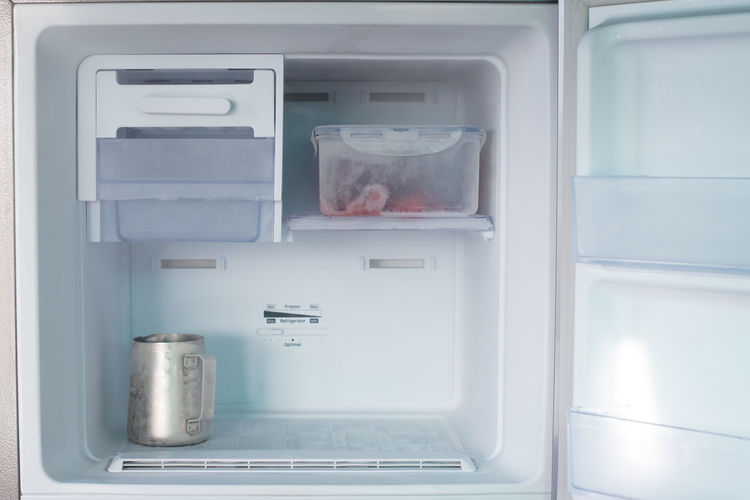 Close-up of container in refrigerator at home