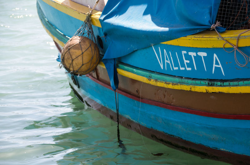 Marsaxlokk Valletta European Capital Of Culture 2018 Valletta,Malta Background Background Photography Background Texture Backgrounds Blue Close-up Colorful Day Fishing Boat Inflatable  Moored Nature Nautical Vessel No People Outdoors Rope Text Transportation Valletta Water Waterfront Yellow