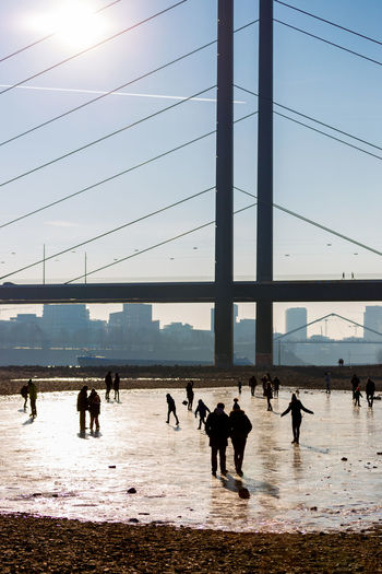 Duesseldorf, Germany Backlight Deutschland Düsseldorf Eis Gegenlicht Ice NRW Rhein Rheinufer Built Structure Clear Sky Day Germany Outdoors People Real People Rheinkniebrücke Sunlight Water #urbanana: The Urban Playground
