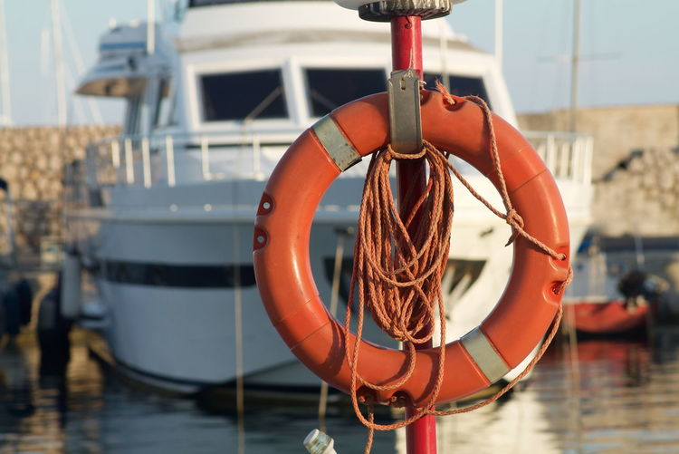 marine life Day Focus On Foreground Hanging Harbor Life Belt Mode Of Transportation Nature Nautical Vessel No People Orange Color Orange Colors Outdoors Protection Rope Safety Sailboat Security Summer Sunlight Transportation Tubing Water 10