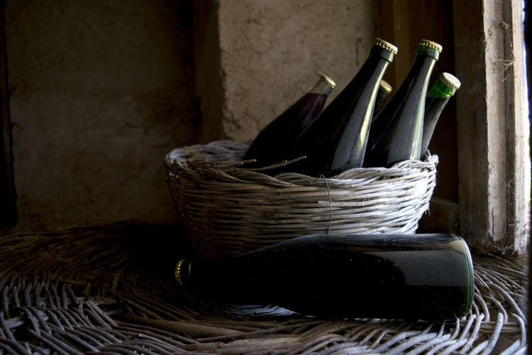 Close-Up Of Bottles In Basket