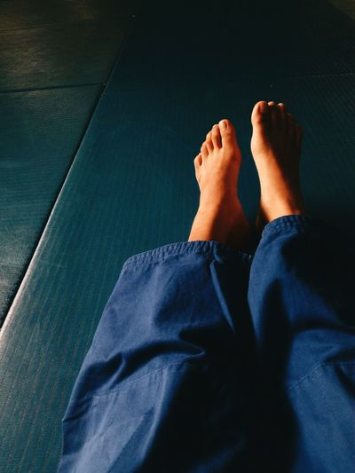 Low Section Of Person On Tatami Mat