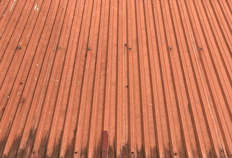 Red metal roof Full Frame Pattern Backgrounds High Angle View Day Metal No People Roof Built Structure Red Architecture Sunlight Outdoors