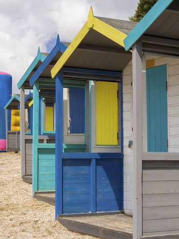 Colourful Beach Huts in Falmouth Architecture Beach Beach Hut Beach Huts And Sky British Building Exterior Cloud - Sky Colourful Day Holiday Hut Multi Colored No People Outdoors Sand Shelter Summer Wood - Material Neon Life