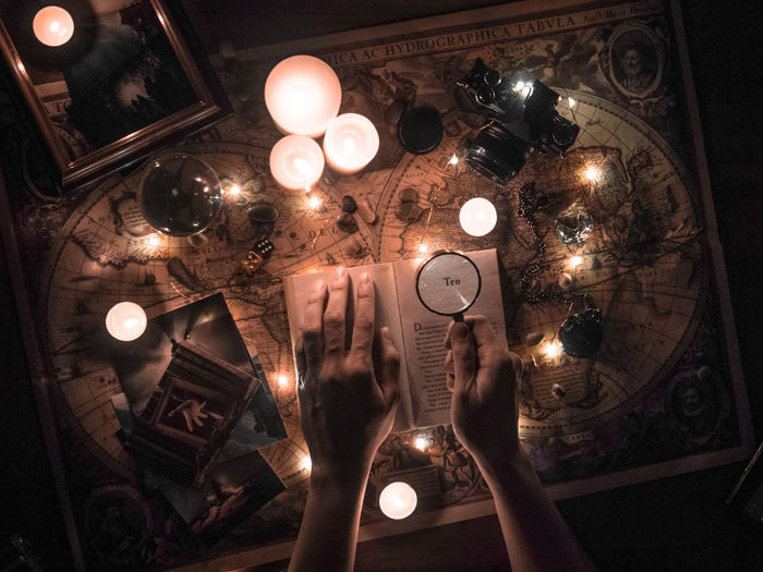 Searching for creativity and adventure. Candle Creativity Map Book Decoration Fairy Lights Flatlay Glowing Hand Human Hand Illuminated Indoors  Lifestyles Light Lighting Equipment One Person Table 10 The Creative - 2018 EyeEm Awards