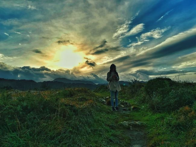 Nature Llanes Asturias Colours SPAIN Clouds EyeEmNewHere Landscape Cloud - Sky Sunset One Person Adult Sky Field People Full Length Grass Standing Photography Themes Nature Outdoors Beauty In Nature Day Shades Of Winter