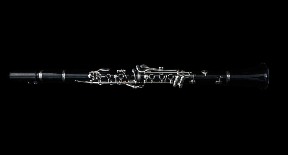 A black clarinet lying down. Music Arts Culture And Entertainment Black Background Black Color Clarinet Close-up Cut Out Detailed Long Lying Down Musical Equipment Musical Instrument No People Single Object Studio Shot Wind Instrument