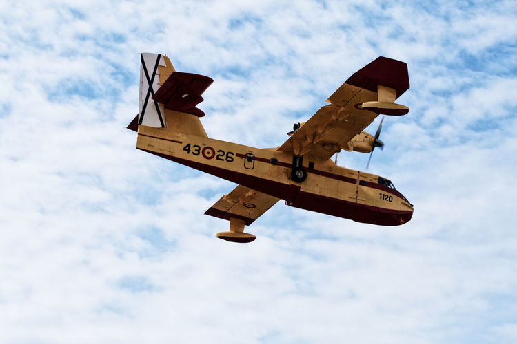 Aerospace Industry Air Force Airplane Blue Canadair Cloud - Sky Day Firefighter FireFighting  Flying Guidance Low Angle View No People Outdoors Red Sea Sky Text Water Yellow