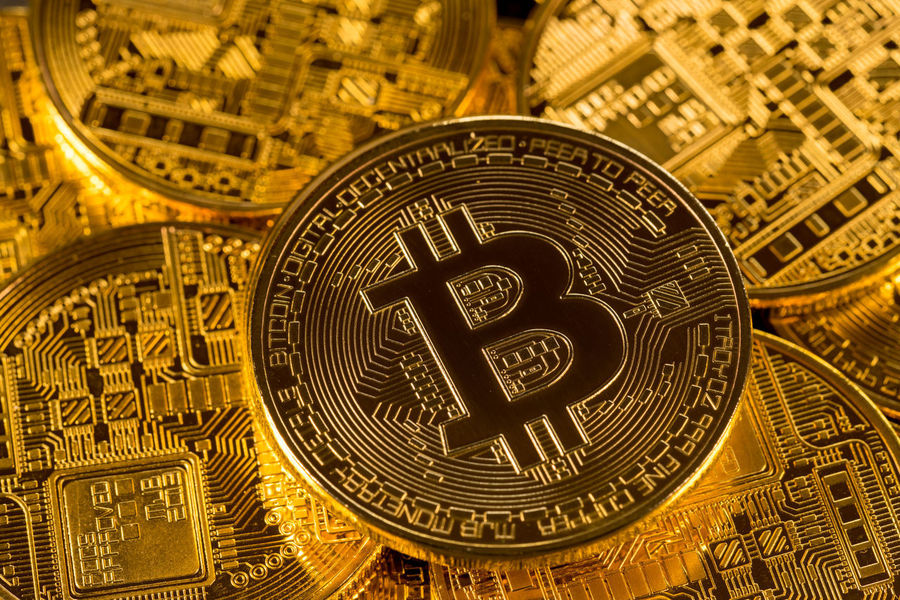 Bitcoin and Ethereum coins to illustrate the rise of cybercurrencies and risk of a market collapse Bubbles Collapse Market RISK Recession Trading Bitcoin Bitcoins Blockchain Cybercurrency Downturn Ethereum Exchange Fall Investment Ledger Price Rise Technology Wealth