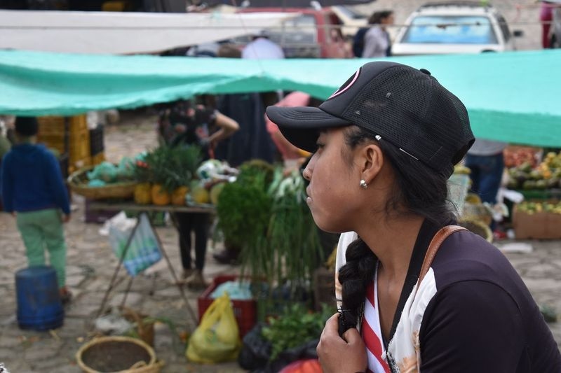 EyeEm Selects Focus On Foreground Real People Incidental People One Person Market Side View Market Stall Outdoors Close-up