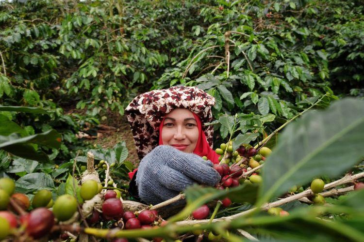 Portrait of smiling woman against clear plants