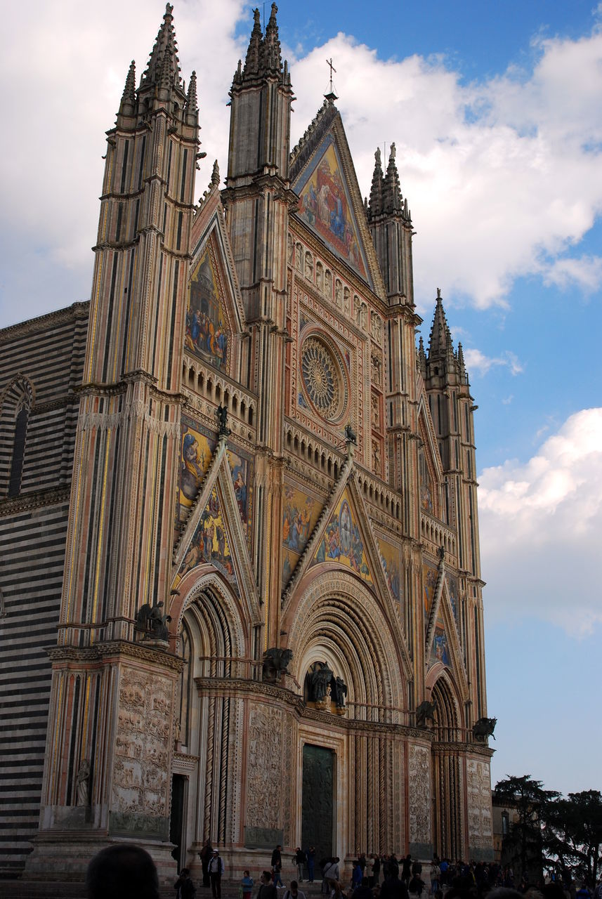 architecture, built structure, building exterior, religion, belief, place of worship, sky, building, spirituality, cloud - sky, low angle view, arch, the past, travel destinations, history, facade, no people, outdoors, gothic style, spire