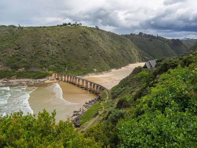 Railway bridge spanning beach and bay in Wilderness, South Africa South Africa Architecture Bay Beach Beauty In Nature Bridge Bridge - Man Made Structure Built Structure Cloud - Sky Dam Day Garden Route Green Color Growth Nature No People Outdoors Power In Nature Railway River Scenics Sky Tree Water Wilderness