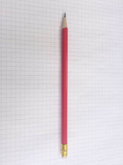 High angle view of pencil on lined paper