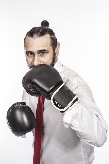 Boxing Businessman Business Fight Punch Competition Boxer Man Strength Concept Fighter Power Suit Sport Glove White Hand Knockout Manager Gloves Equipment Competitor Combat Job Martial Competitive Success Sportswear Anger Leader Strong