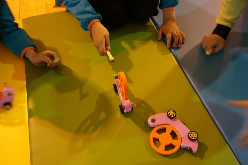 Cropped image of kids playing with toys