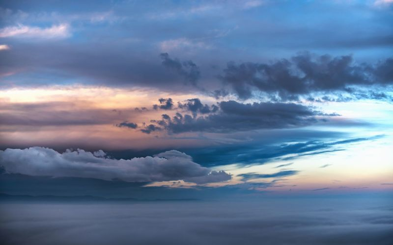Can you see the horizon? Cloud - Sky Scenics - Nature Tranquility Sunset Idyllic Nature Dramatic Sky Outdoors Cloudscape Backgrounds Low Angle View Moody Sky Overcast Meteorology Sea Of Fog