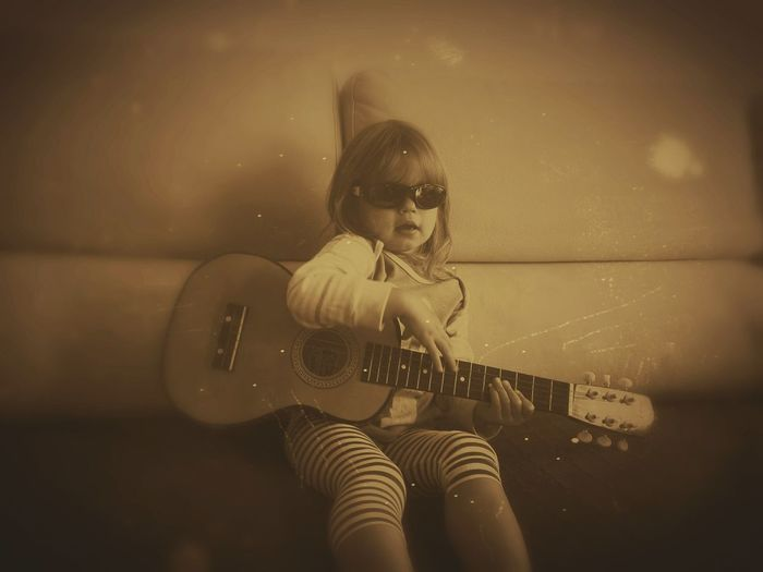 One Person Happiness Guitar B&W Photo Lifestyle The Portraitist - 2017 EyeEm Awards Learn & Shoot: Simplicity Monochrome Monochrome _ Collection Little Musician Blues Guitar Young Rocker Sepia Photography Sepia_collection Live For The Story Girl Imitation Playing Guitar!love It! Playing Guitar EyeEmNewHere Be. Ready. Childhood Elementary Age Playing Leisure Activity Indoors  Lifestyles Space Suit Futuristic Standing Sunglasses