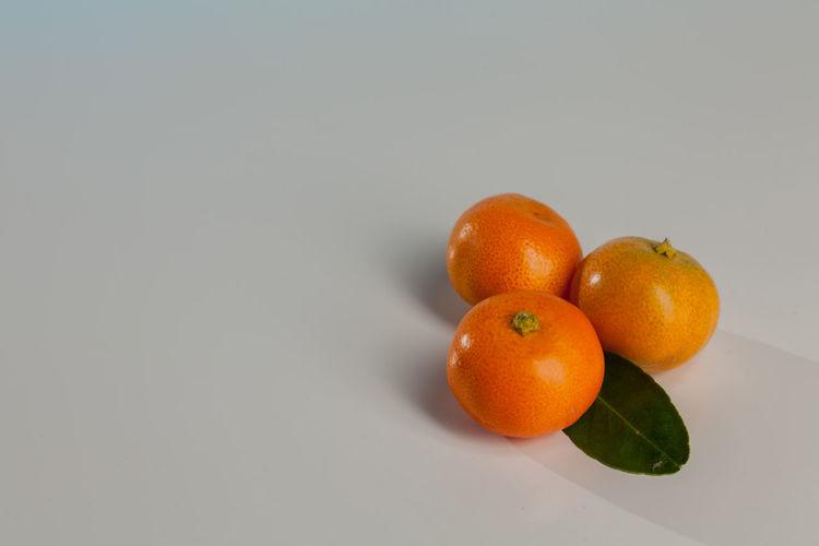 Citrus Fruit Close-up Copy Space Food Food And Drink Freshness Fruit Group Of Objects Healthy Eating Indoors  Leaf No People Orange Orange - Fruit Orange Color Plant Part Ripe Still Life Studio Shot Wellbeing White Background