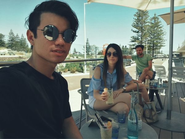 Young Adult Looking At Camera Portrait Togetherness Adults Only Sunglasses Young Women Holding Friendship Confidence  Adult People Day Cooperation Business Finance And Industry Connection Outdoors Teamwork Sky Cocktails Cocktail Time Dessert Restaurant Summer