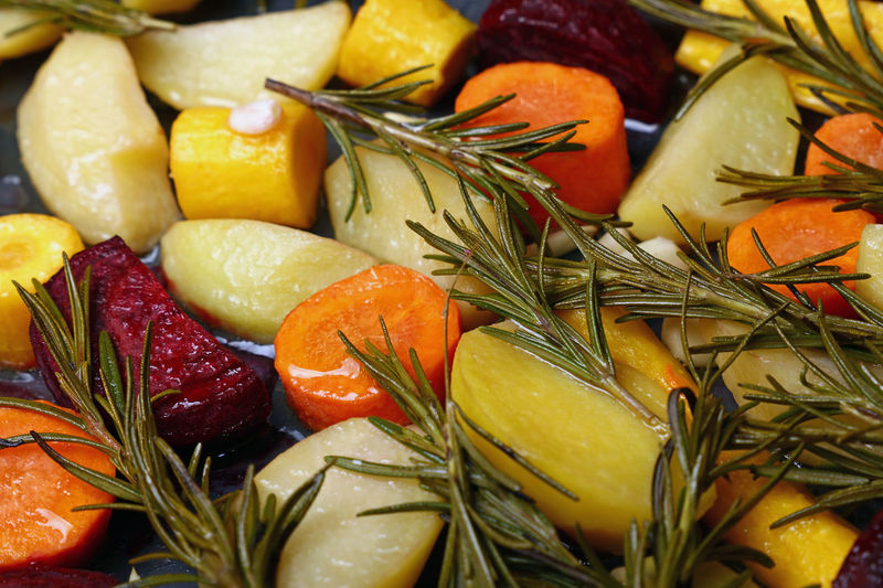 Full frame shot of roasted vegetables with herb in plate