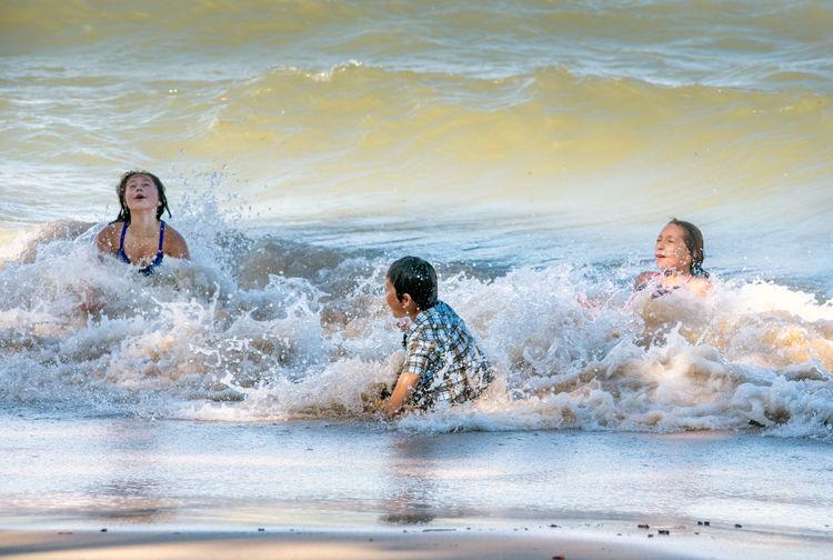 People enjoying on beach