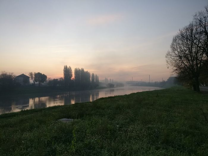 Fog Outdoors No People Nature Beauty In Nature Cloud - Sky Grass Autumn Springtime Sunset Water Scenics Tree Dawn Lake Sky Landscape Rural Scene Day