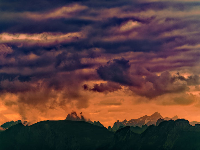 Cloud - Sky Sky Beauty In Nature Sunset Scenics - Nature Tranquil Scene Tranquility Mountain Nature Idyllic Non-urban Scene Mountain Range No People Silhouette Environment Orange Color Outdoors Landscape Dramatic Sky Formation Mountain Peak