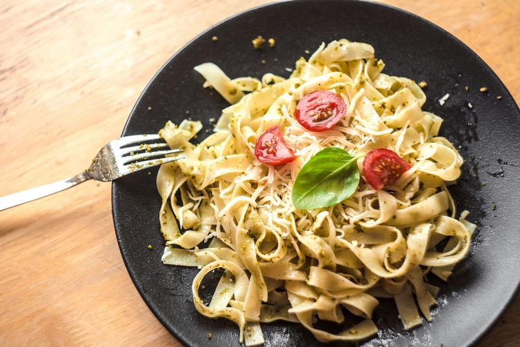 Close-Up Of Served Pesto Pasta On Plate