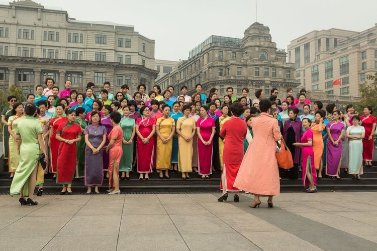 Preparing for a group photo in a beautiful Shanghai setting. Shanghai China Storytelling Streetphotography Group Of People Large Group Of People Built Structure Real People Architecture Building Exterior Women Traditional Clothing Lifestyles City