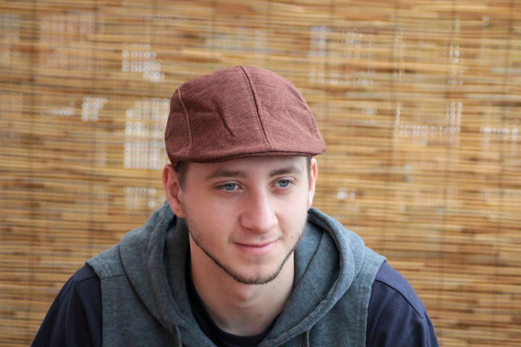 Portrait of young man wearing hat during winter
