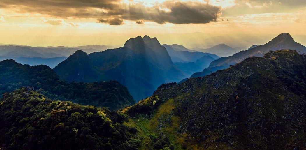 Panoramic beautiful scenic mountain range with blue sky, cloud and blast horizon sun