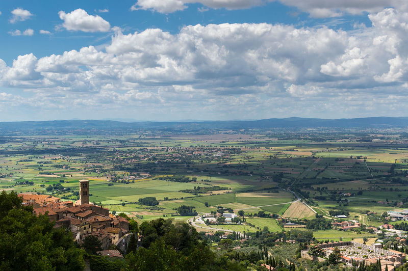 Panorama of Val di Chiana with Cortona city. Tuscany Italy City Panorama Tuscany Val Di Chiana  Agriculture Beauty In Nature Cloud - Sky Cortona Countryside Day Field Italy Landscape Nature Outdoors Rural Scene Scenics Sky Tranquil Scene Travel Destinations Tree
