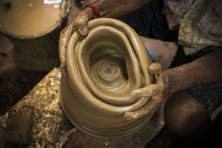 Shaping up the clay Art And Craft Craft Working Human Hand Hand Pottery One Person Occupation Skill  Creativity Clay Real People Human Body Part Spinning Making Workshop Men Expertise Molding A Shape Indoors  Preparation  Mud India Clay Work Hardwork